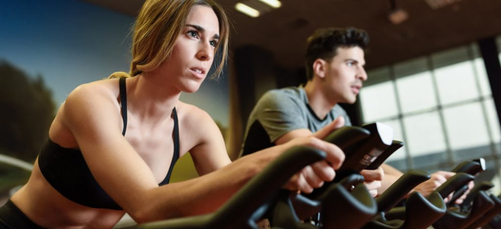 Woman and Man on an Upright Exercise Bike