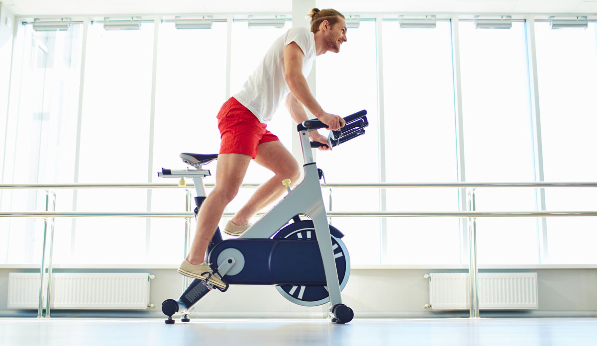 A man doing HIIT on an exercise bike
